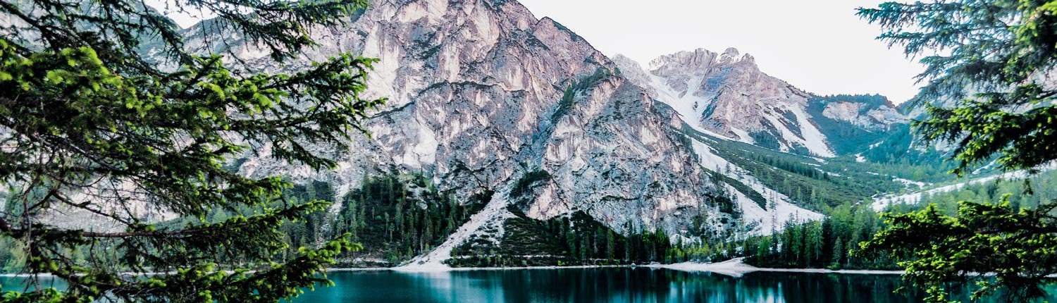 Mountains reflected in an alpine lake - nature therapy