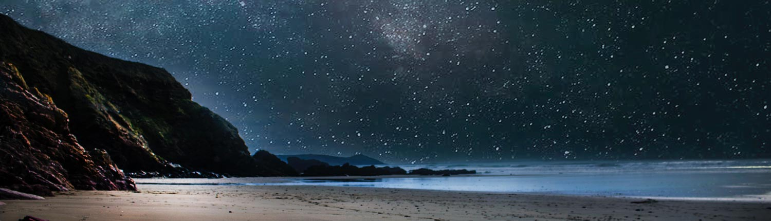Stars twinkling where mountains meet the ocean - nature therapy
